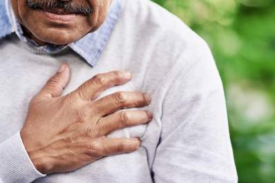 Senior man having chest pain.