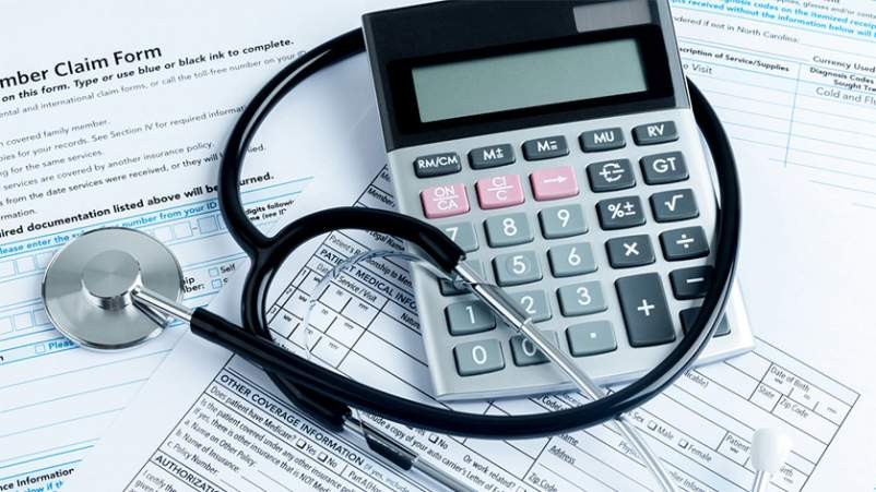 Rising health care costs, forms, stethoscope, and calculator.