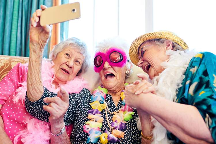 Senior friends taking a selfie having fun.