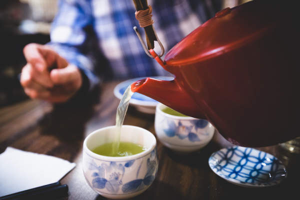 Pouring cups of green tea