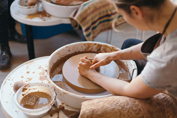 Woman working on a pottery wheel