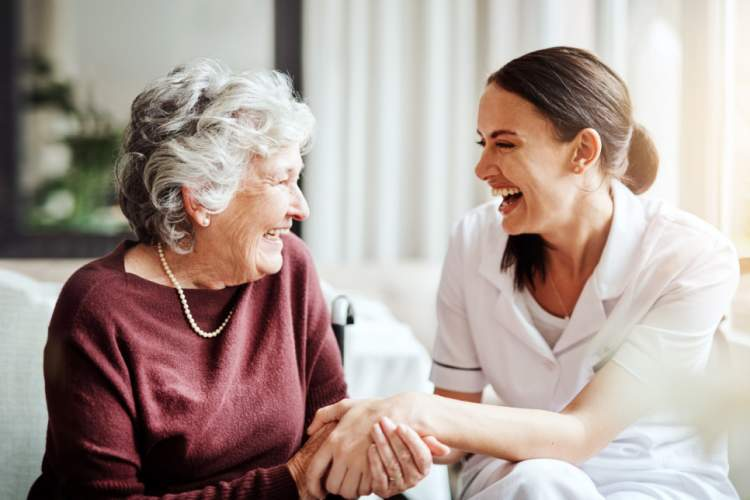 senior woman with young caregiver