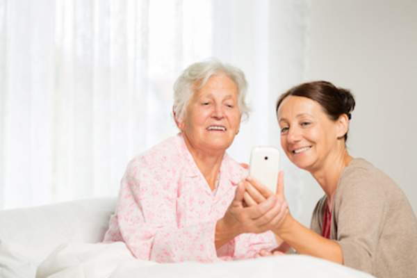 Caregiver and ward on smartphone app.