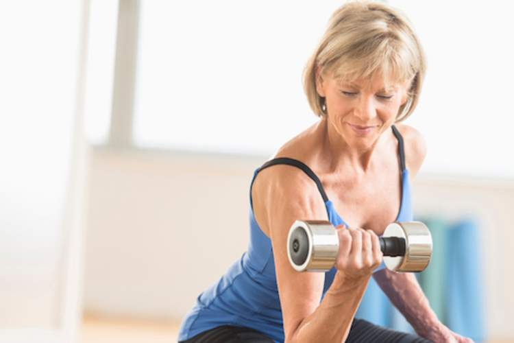 Older woman lifting dumbbell.