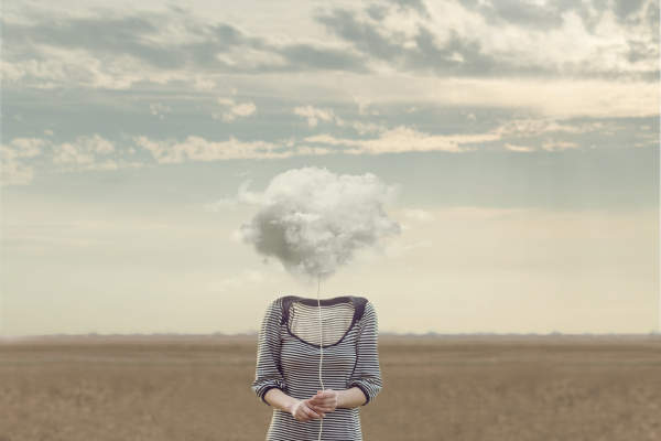 Woman whose head is replaced with a cloud