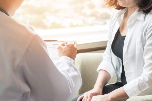 Doctor consulting with female patient