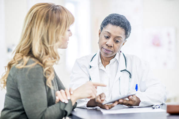 Woman discussing treatment options for uterine cancer with her doctor.