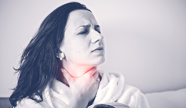 Woman experiencing thyroid pain