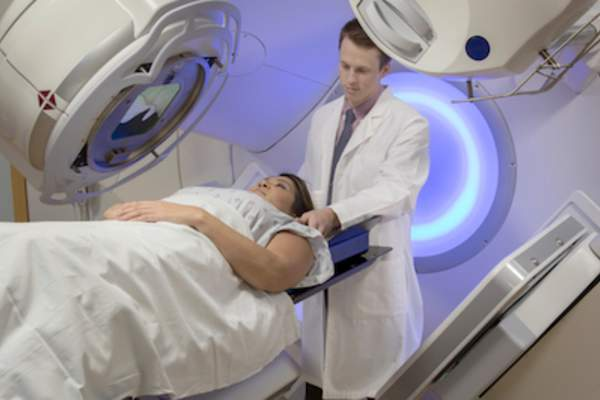 Doctor setting up patient for radiation therapy.