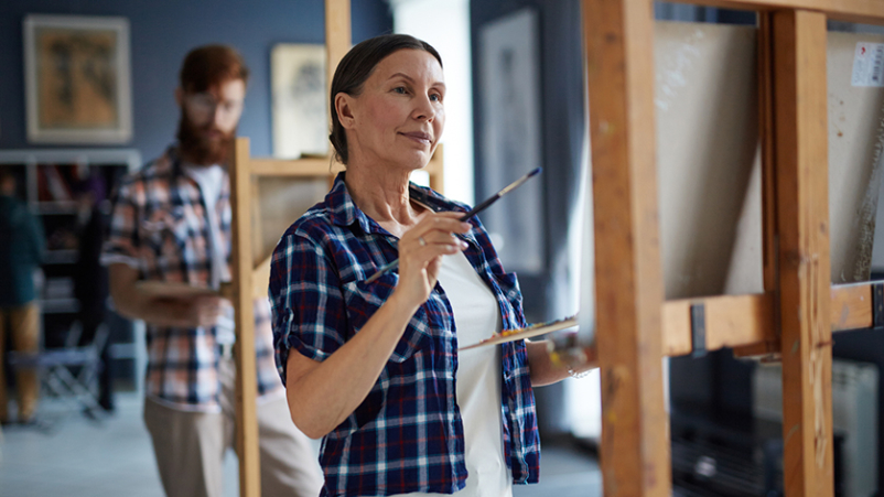 Middle age woman in a painting class.