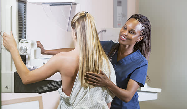 Woman getting a mammogram.