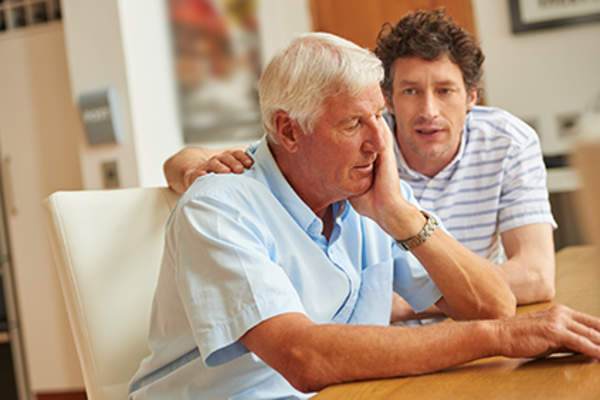 Senior man unhappy with his son's tone of voice.