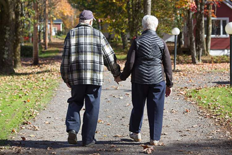 Elderly couple walking.