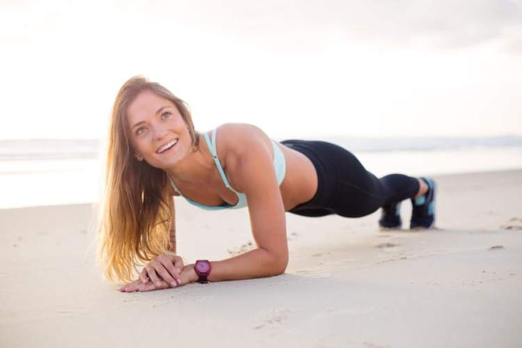 woman on beach in plank position