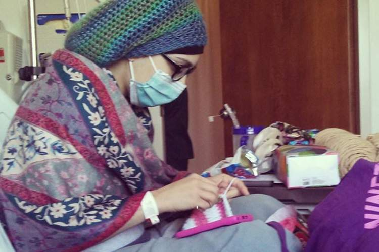 Nadia crochets in the hospital.