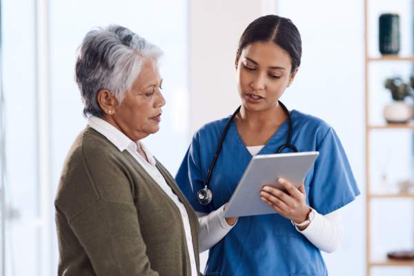 senior woman talking to nurse
