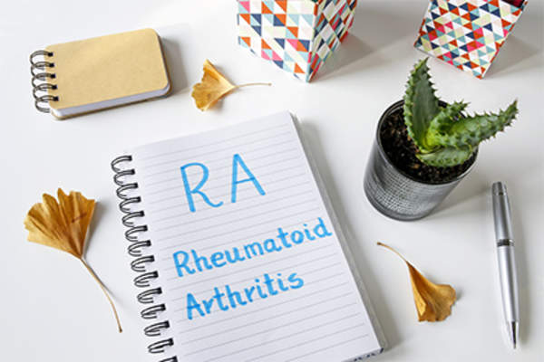 RA rheumatoid arthritis notes in notebook.