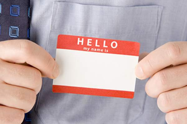 Businessman Attaching Blank Name Tag