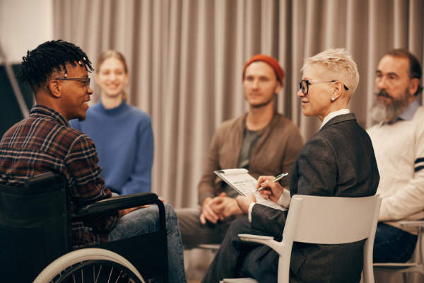 man in wheelchair at support group