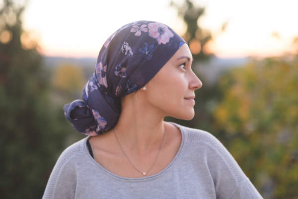 Young woman with breast cancer looking hopeful
