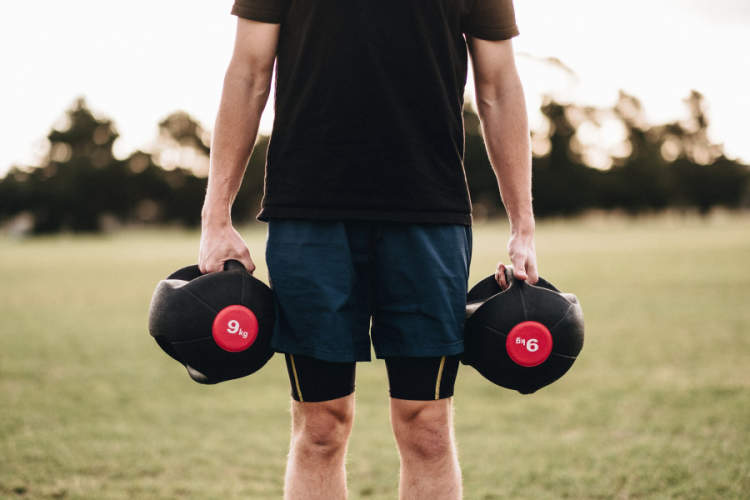 man holding dumbbells