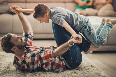 Man playing with his son could trigger a rheumatoid arthritis flare.