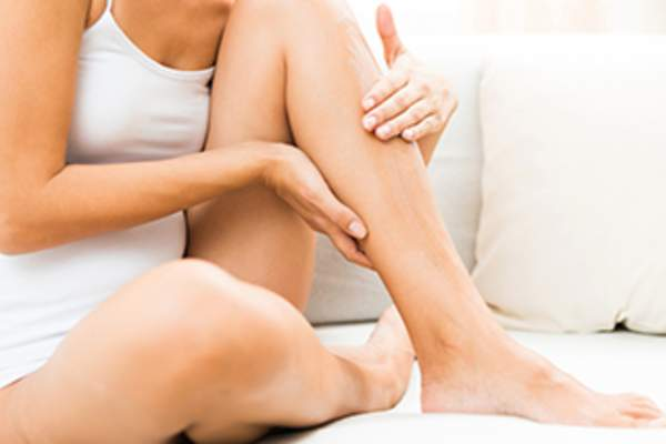 Woman with leg cramp image.