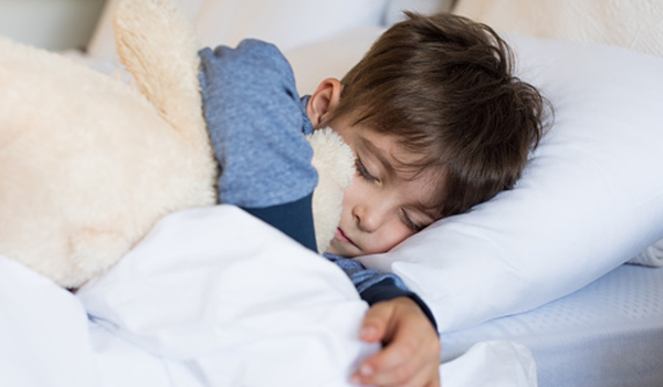 young boy dreaming asleep image