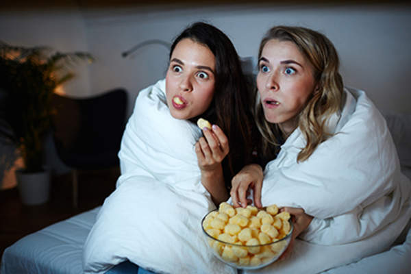 Women snacking together at night.