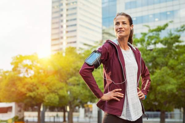 woman wearing workout clothes looking confident