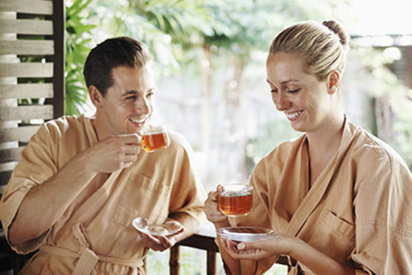 Couple drinking herbal tea at a spa.