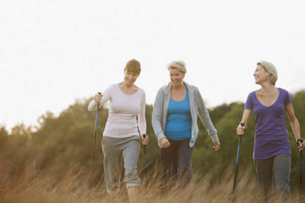 Three older caucasian women hiking.