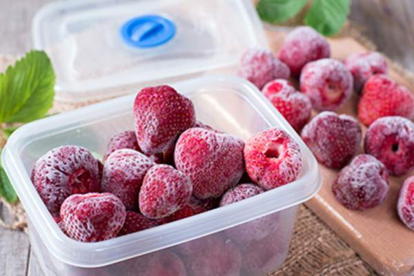 Frozen strawberries in a container