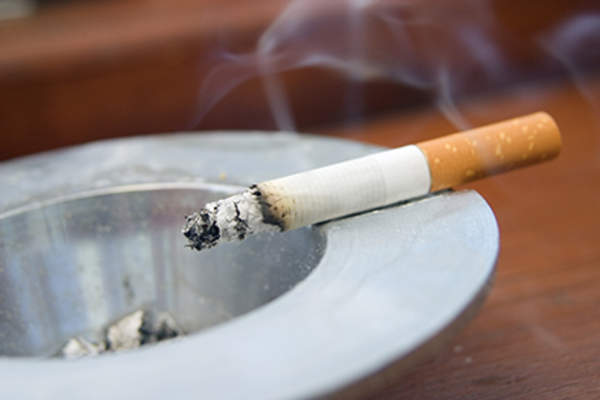 Cigarette on an ashtray.