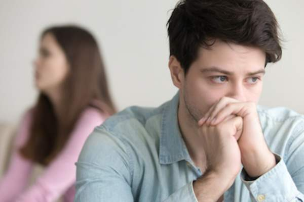 Upset guy deep in thoughts, argument with girlfriend, fertility troubles.