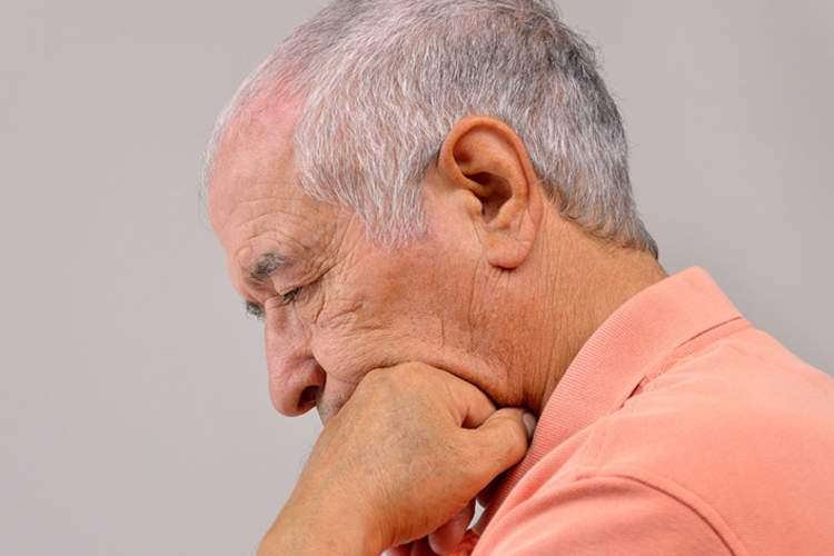 Senior man with depression and hearing loss.