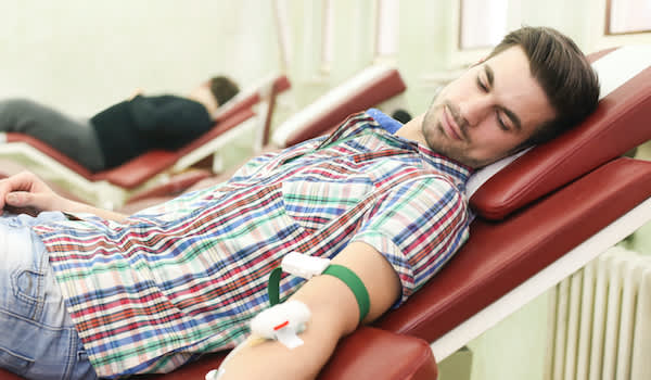 Man donating blood.
