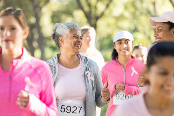 Women running in a 5k for breast cancer charity
