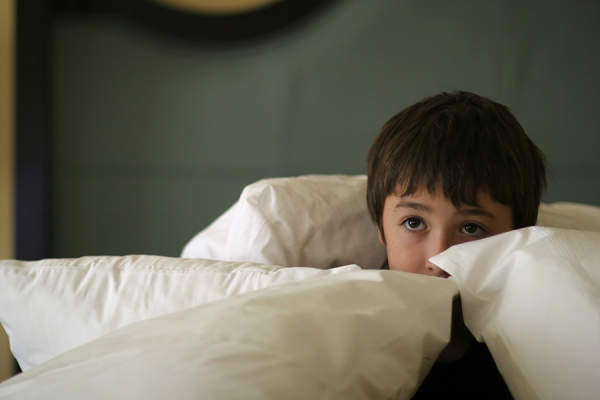 Scared little boy in bed