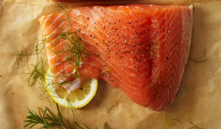 raw salmon seasoned with salt, pepper, thyme and lemon.