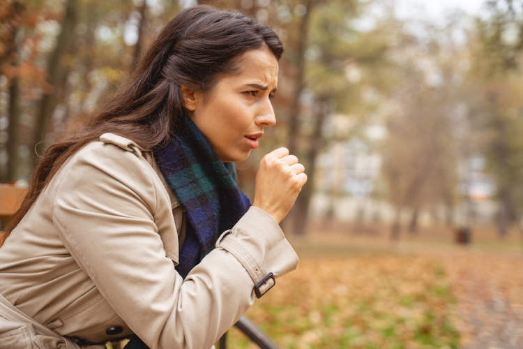 coughing woman