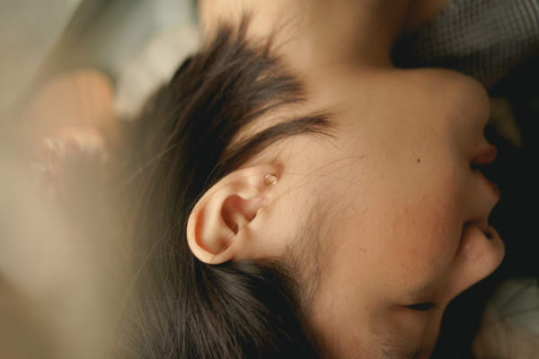 woman sleeping, ear visible