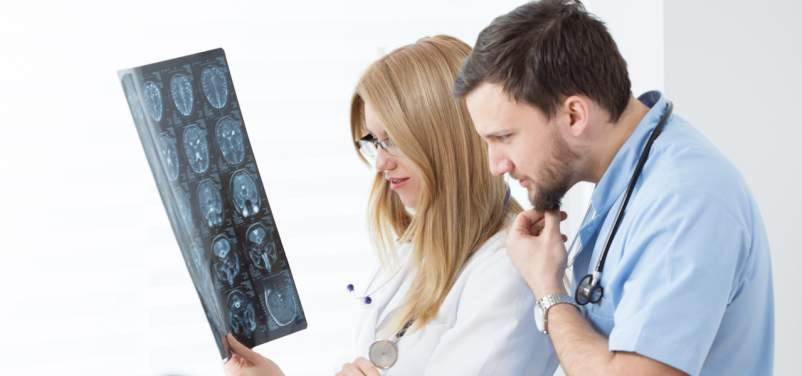 doctors looking at MRI scans