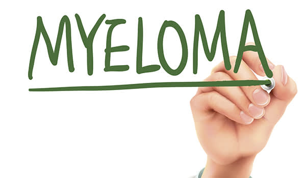 A hand writing the word myeloma.