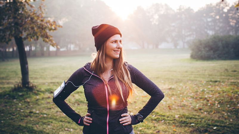 Woman going for a jog outdoors in the winter to combat seasonal anxiety.