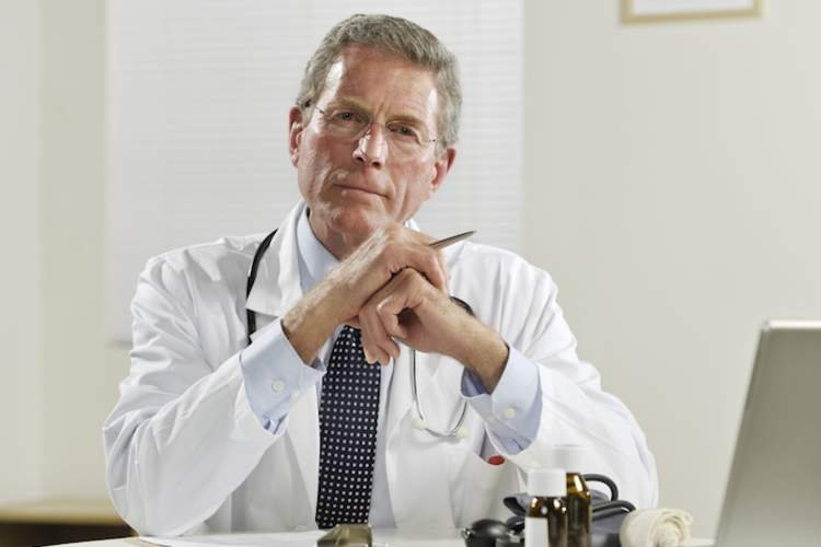 Smug, white, male doctor.