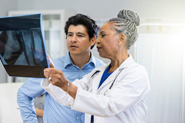 Doctor explaining x-ray results to a patient.