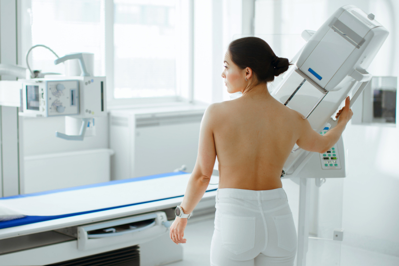 Woman getting a mammogram to screen for breast cancer