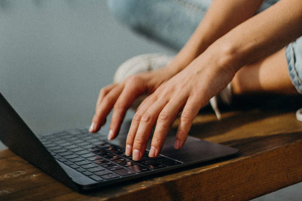 close up of hands typing