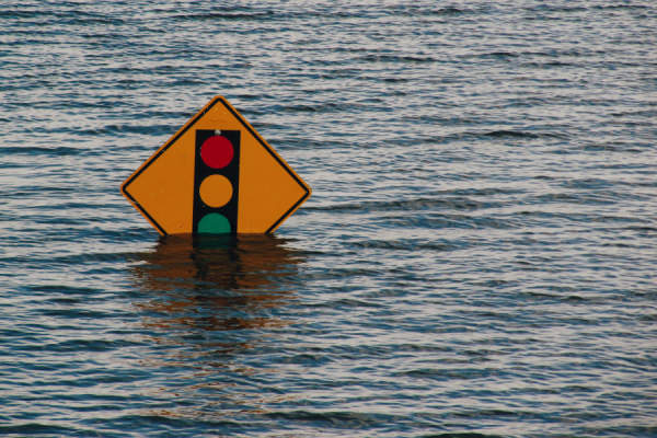 Traffic sign being drowned during flooding